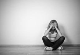 bigstock-girl-sits-in-a-depression-on-t-52227706-300x207